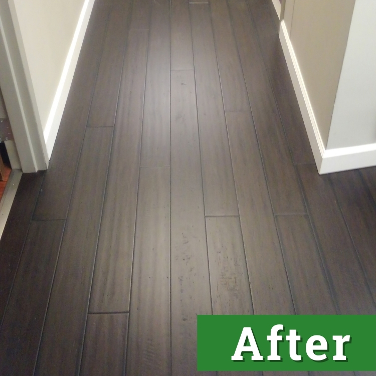 newly installed dark wood laminate down a hallway