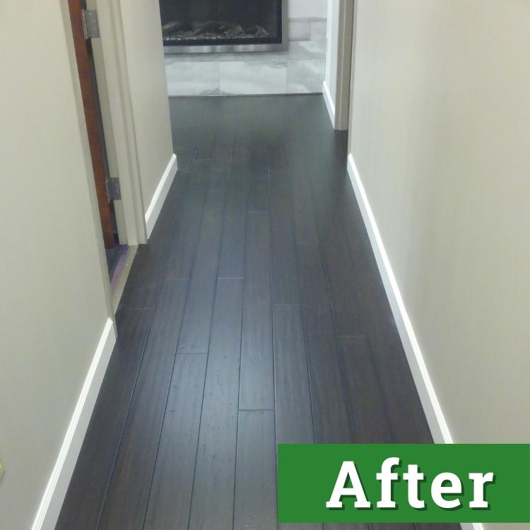 newly installed dark wood laminate flooring extends down a long hallway