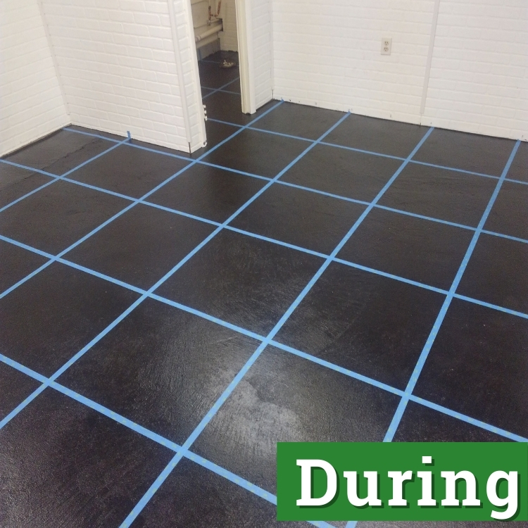 a black floor with blue tape in marking a grid