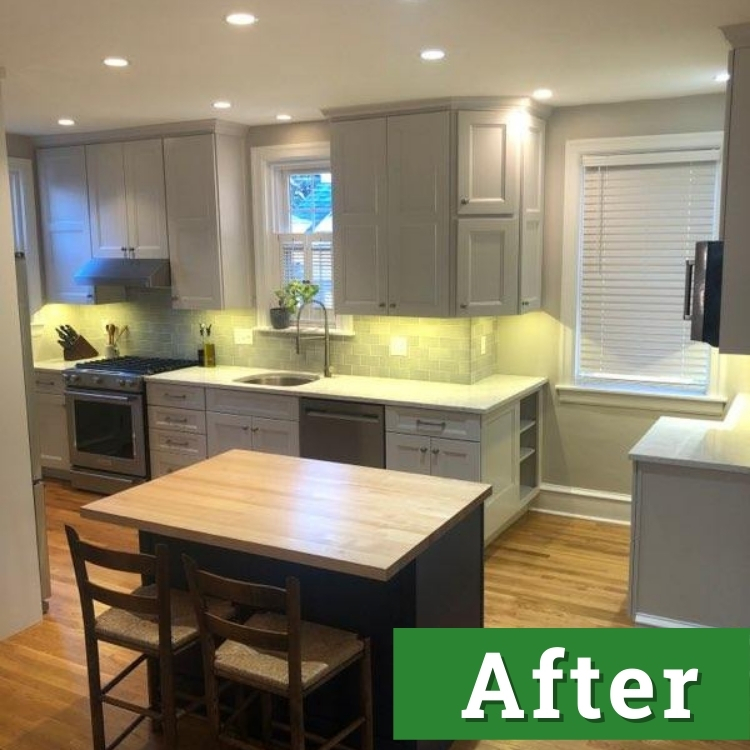 a brightly lit kitchen with new white cabinets