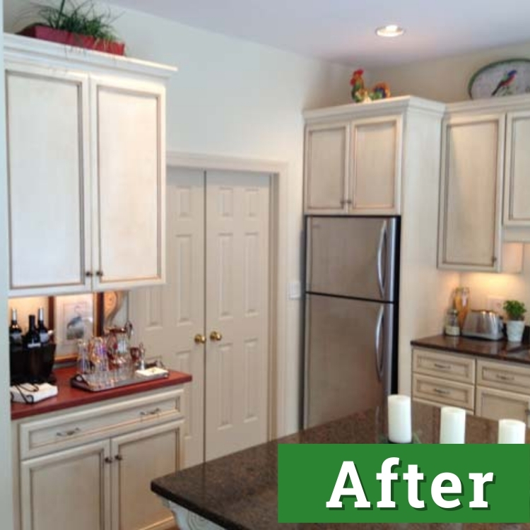 a brightly lit kitchen with white cabinets and stainless steel appliances