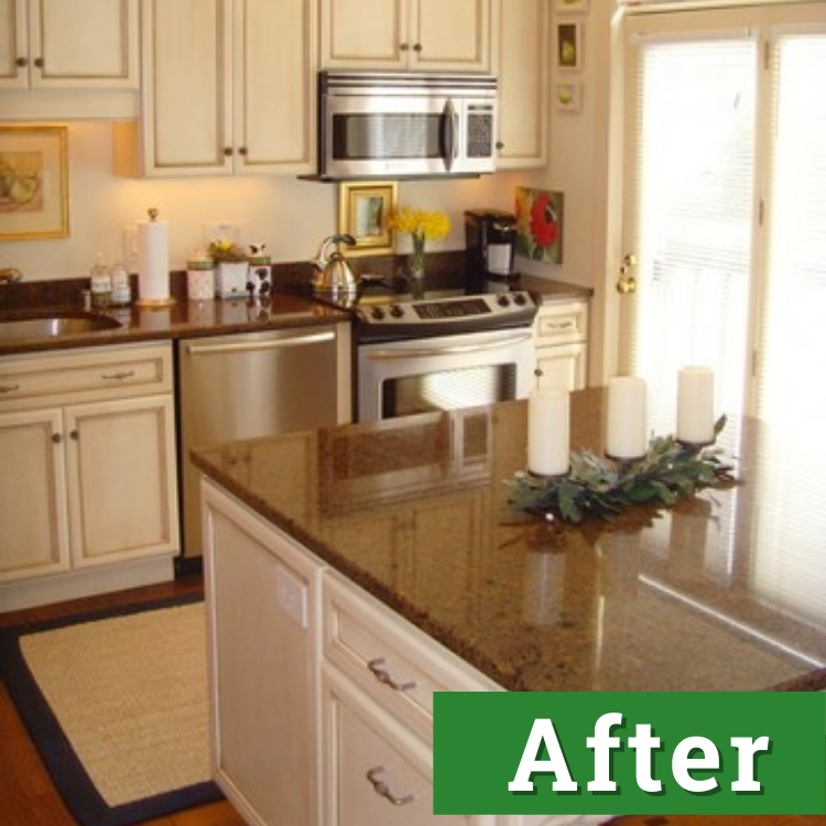 a newly remodeled kitchen with white cabinets and stainless steel appliances