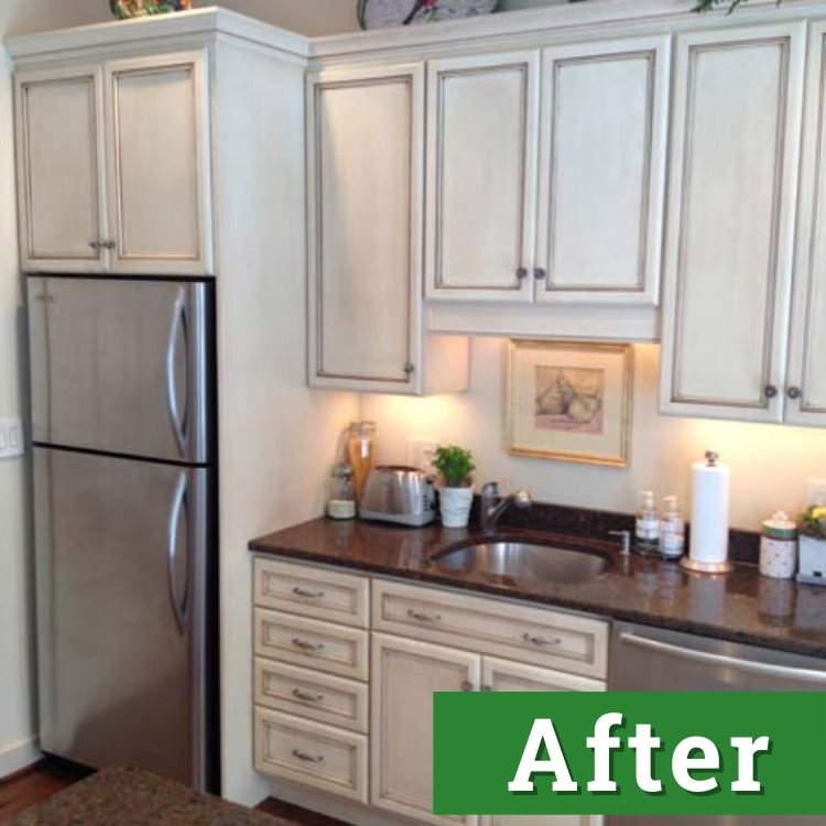 a wall of white cabinets with brown marble countertops
