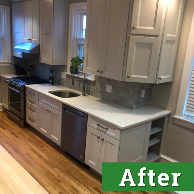 white cabinets and new stainless steel appliances in a newly renovated kitchen