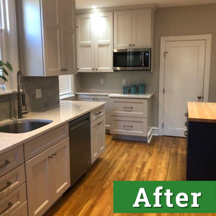 a newly renovated kitchen with white cabinets and stainless steel appliances