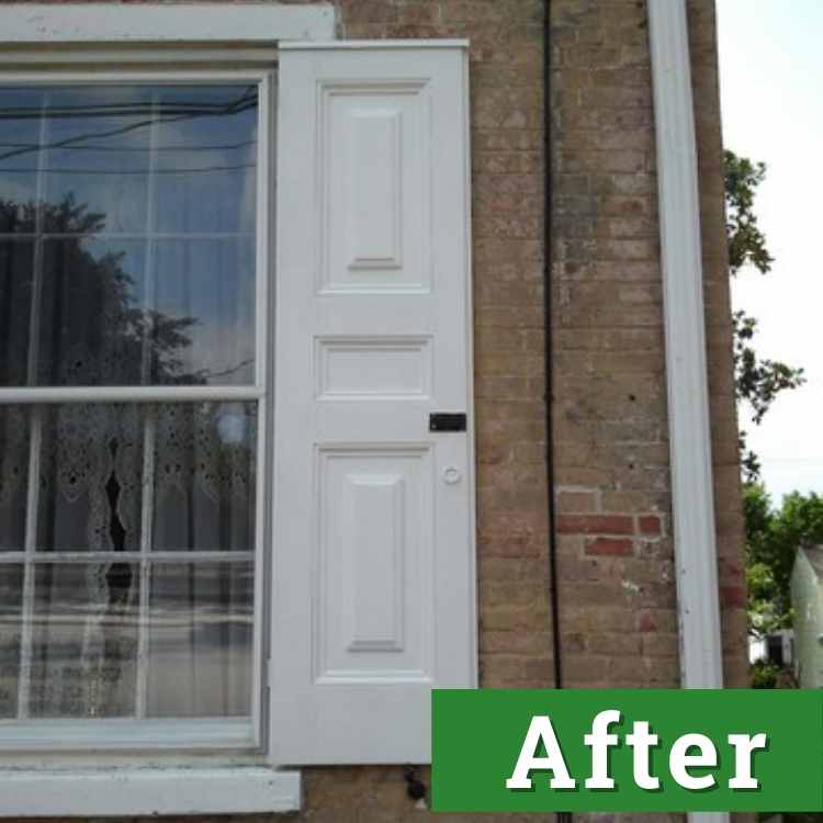 a newly painted white shutter