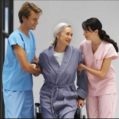 Nurse aides (CNA) caring for a patient in assisted living