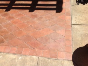 stripped mexican paver patio