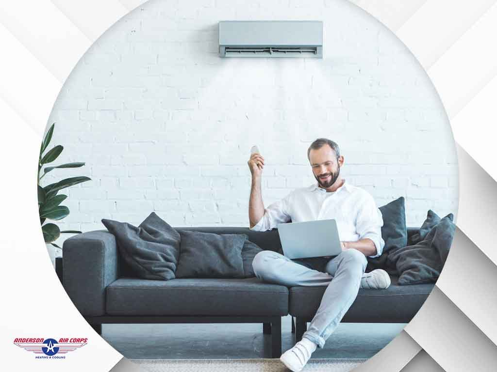 man on couch with his computer