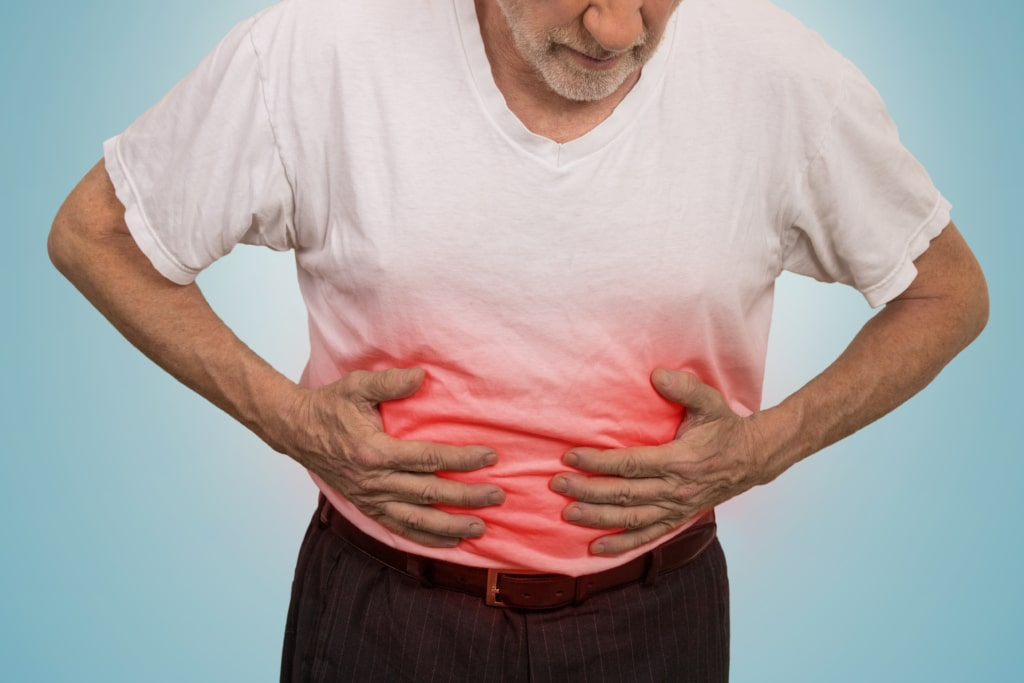 man holding his belly in pain