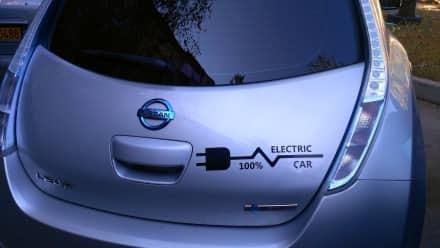A silver Nissan electric car