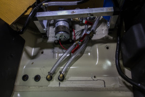 Progress on the inside setup with pump and hoses. Filter on right. Behind/under driver's seat