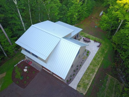 RHEINZINK Blue-Grey Standing Seam Roof Panels & S-5 ColorGard Snow Retention