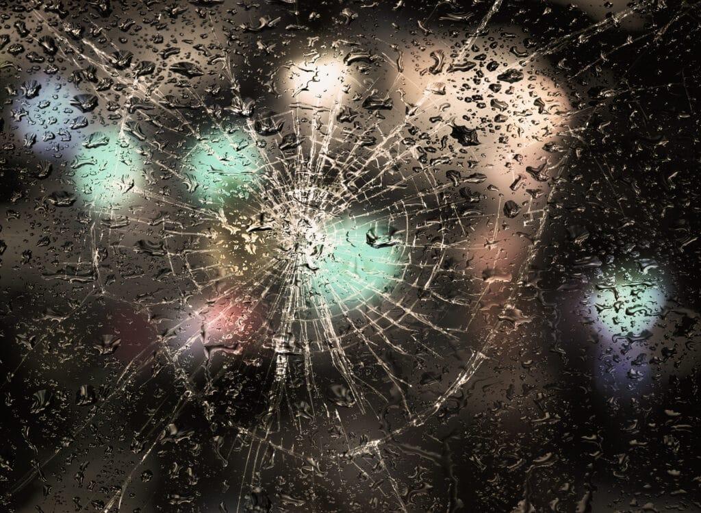 Rainy weather, the inscription on the sweaty broken glass question markRainy weather, raindrops on the sweaty broken glass