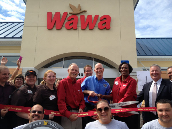 Florida Governor Rick Scott  stands in front of the First Wawa store in Florida.