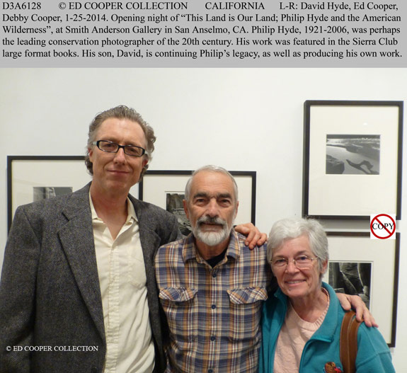 "David Leland Hyde, Ed Cooper And Debby Cooper At The Opening of ""This Land Is Our Land."" Ed Cooper was another mainstay photographer for the Sierra Club, his work appearing in the famous Sierra Club calendars of the 1970s and 1980s that contained the who's who of landscape photography at the time. He is a well-known mountaineering large format photographer. His latest book, ""Soul Of The Rockies"" came out in 2008."