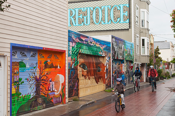 11. Bicyclists Rejoice, Murals, Balmy Alley, Mission District, San Francisco, California. I agree with Nina Simone that an artist's responsibility is to reflect the times. I show the general mood and place where the murals are, without recording any of them specifically, but rather, transforming their combination into a telltale scene. I intend to draw attention to the neighborhood and encourage people to go see this incredible, often political art. I clicked one frame before the bicyclists came happily along and idealized the composition. Riding bicycles will become more and more a sign of the times in the future.