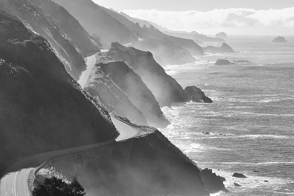 16. California Highway One From Above, Big Sur Coast, Pacific Ocean, Los Padres National Forest, California. The color version of this is beautiful with a sapphire blue ocean and gold illuminated plants on the cliffs, but I feel the black and white version somehow transports us to another time with the help of winding two-lane State Highway 1. Climbing several hundred feet above the highway also gives this a unique perspective. I had to watch out for Poison Oak, which is prolific in Big Sur. In the end I was not careful enough and drove home with the rash on my face, forearm, ankle and calf.