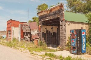 Abandoned Buildings and Pepsi Vending Machine, Inavale, Nebraska, 2015 by David Leland Hyde.
