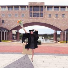 graduation robe Bond University business degree