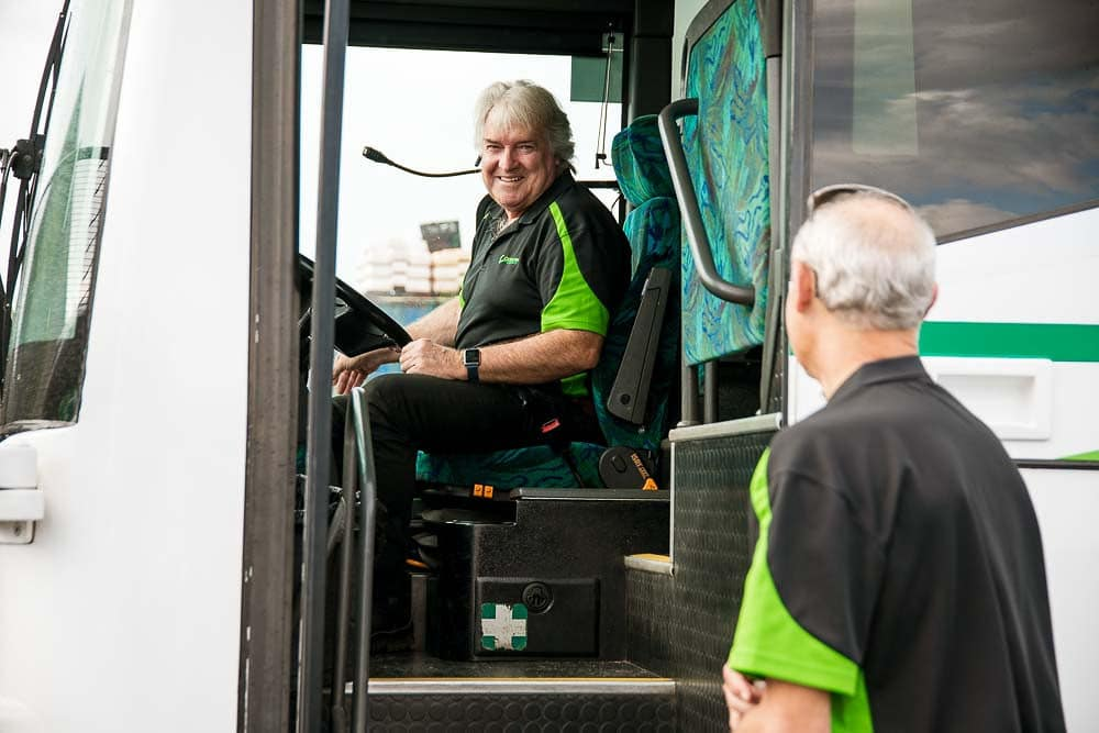 bus driver from coolum coach chatting with other employee