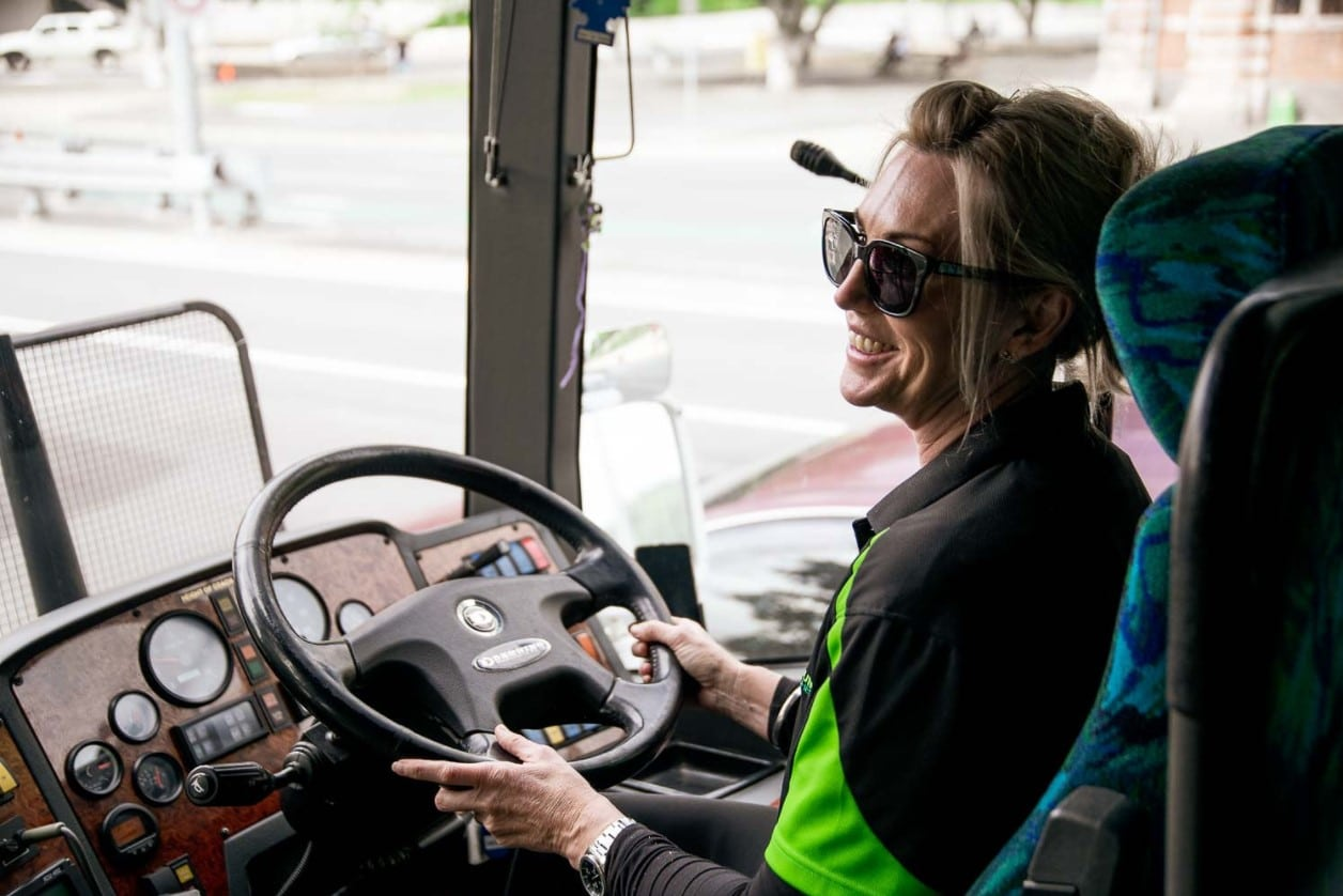 bus driver from coolum coaches smiling while driving
