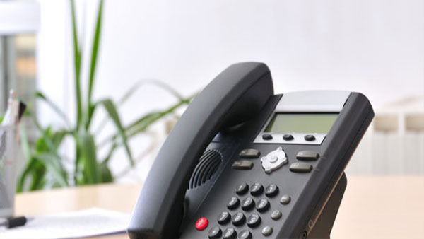 A Telephone on a desk using AdcommTVs phone services