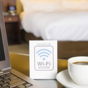On a sign, this hotel has wifi access with a cup of coffee.