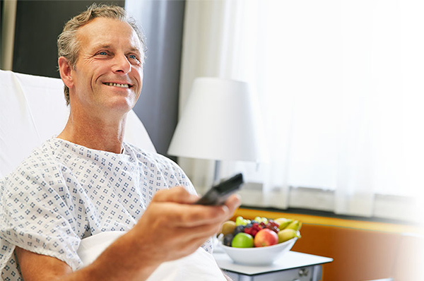 Man watching a Commercial TVs for Healthcare