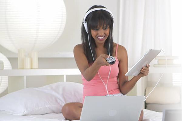 Women student using AdcommTV Student Housing market commercial TV, internet and HDTV