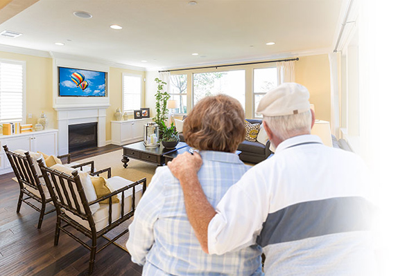 A Senior Couple watching an AdcommTV Commercial TV