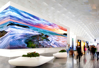 View of a wall displaying large digital signage