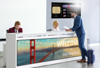 View of individuals discussing digital signage