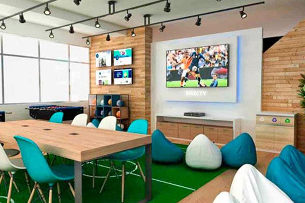 Adcomm TVs inside an office space break room