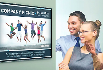view of coworkers enjoying digital signage for offices