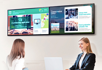 Two tvs displaying digital signage for offices