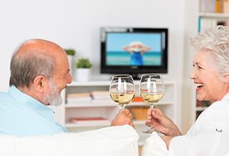 View of a couple enjoying TV & Internet Senior Living