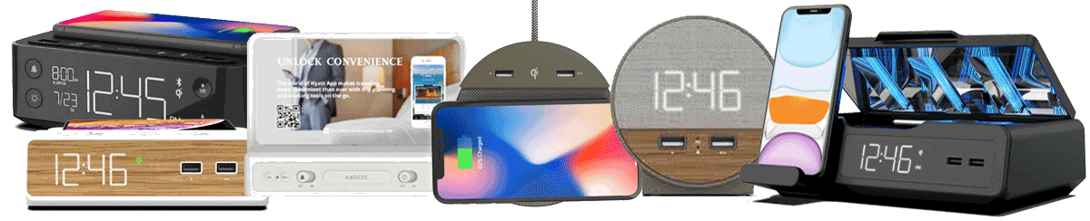A variety of alarm clock and charging devices. Part of AdcommTVs in-room amenities