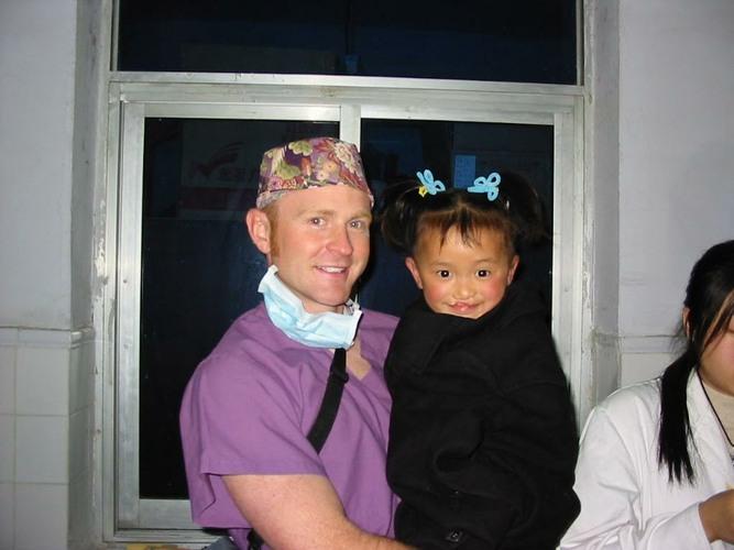 Dr. Griner holding child