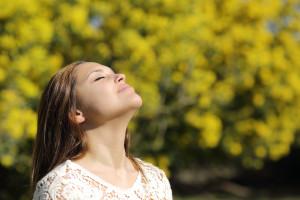 Woman breathing deep in spring or summer