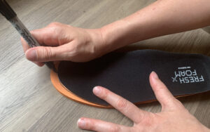 Step 2 of how to trim you insoles in 4 simple steps; Use the liner from the shoe as a pattern