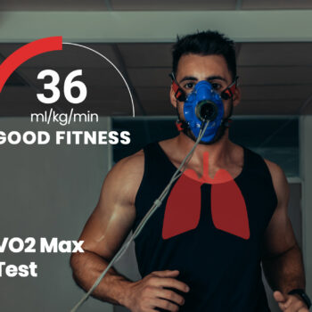 Middle-aged man doing a VO2 Max Test on a treadmill in a black tank top.