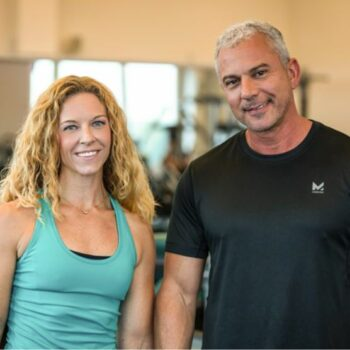 Todd Miller, Live Lean Rx nutritionist, in a black shirt next to his female associate.