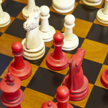 Chess board with red and white pieces