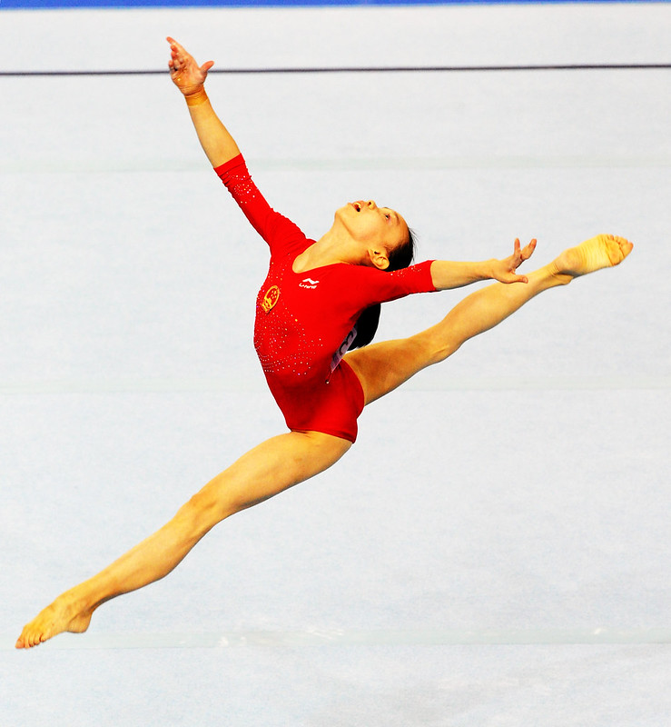 gymnast in mid-routine