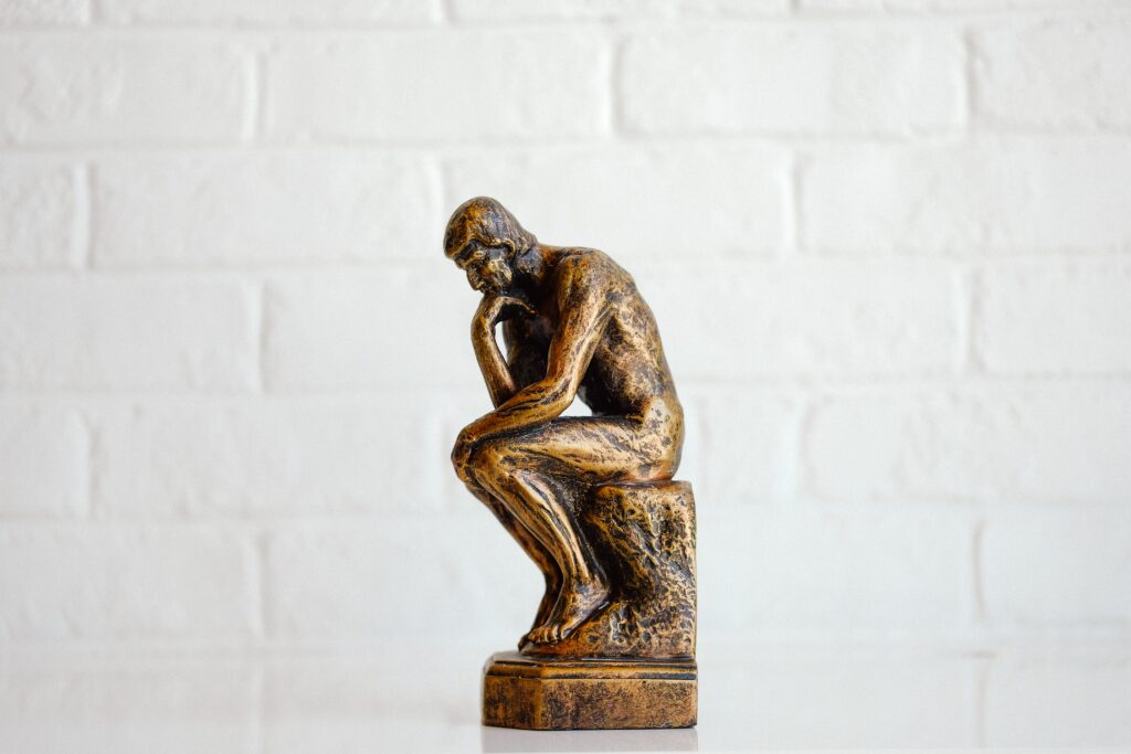 sculpture of a man lost in thought