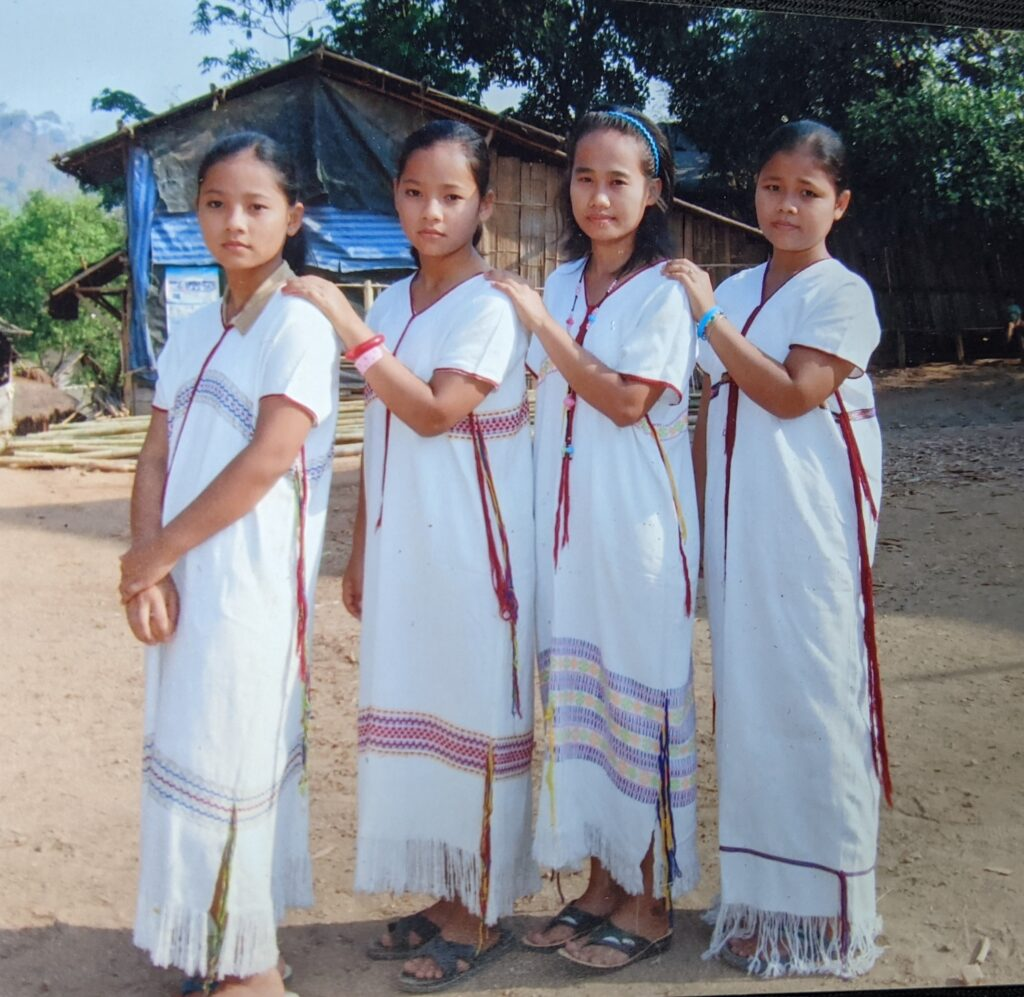 Fairymoo with her sisters are wearing traditional white symbolizing that they are single.