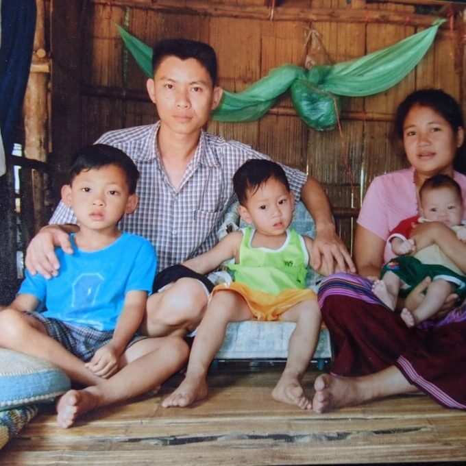 Fairymoo and her family in Thai refugee camp.