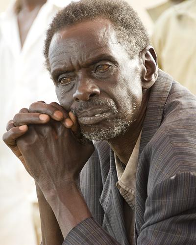 Millennium Village - Mayange, Rwanda.  Man leaning on hands.