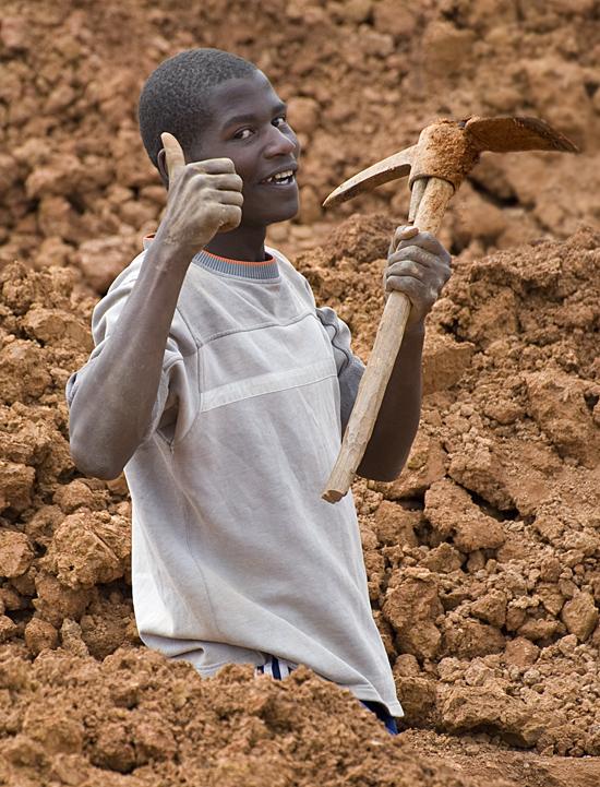 Worker at Butaro hospital construction site, Rwanda